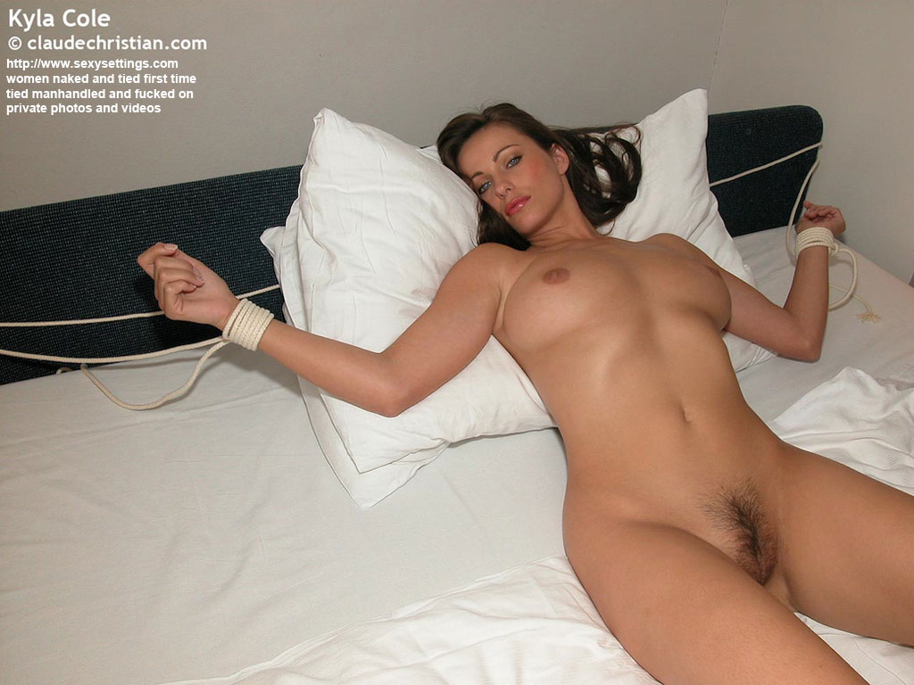 nude female tied to bed