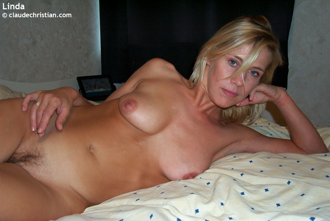 Nude blonde wives in bed legs spread