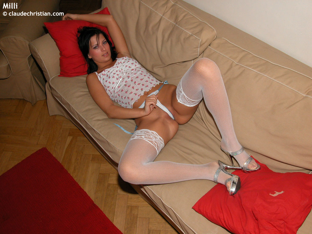 this sexy brunette babe shows her amazing cock ride on the sofa